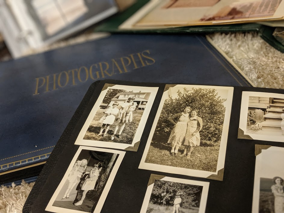 Scrapbook and Photo Album with cover that reads 'Photographs' with old sepia photos to show family legacy. For the Legacies that Last: Preserving Your Memories with Legacy Scrapbooks and Heirloom Albums post on the Legacy Estate Planning Blog. Image credit to Heather Agun